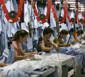 Factory workers making t-shirts